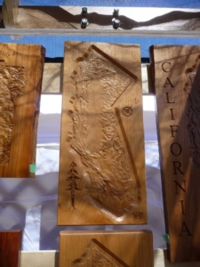 Topographical maps in a variety of wood species