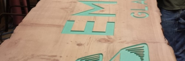 WoodLab Designs Sanding Process for Emerald Glass Gallery Signage