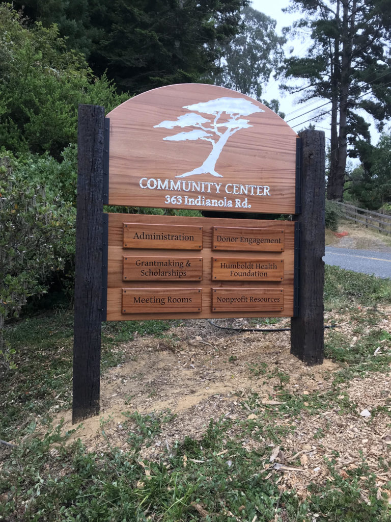 WoodLab Designs Humboldt Area Foundation Wayfinding Sign made from Sapele Mahogany, CNC Cut Metal Letters, and Laser Etching