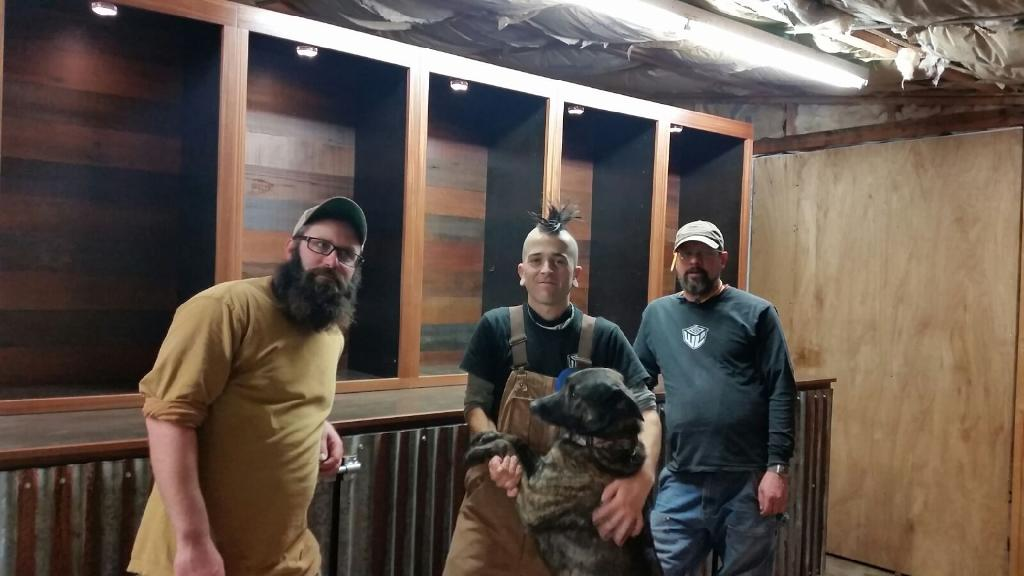 WoodLab Guys Jeremy Harris with Redwood Roots Finished Display Cabinets