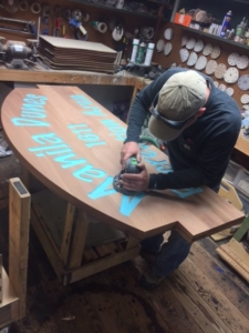 WoodLab Designs Salvaged Redwood CNC carved & painted sign for Manila Dunes