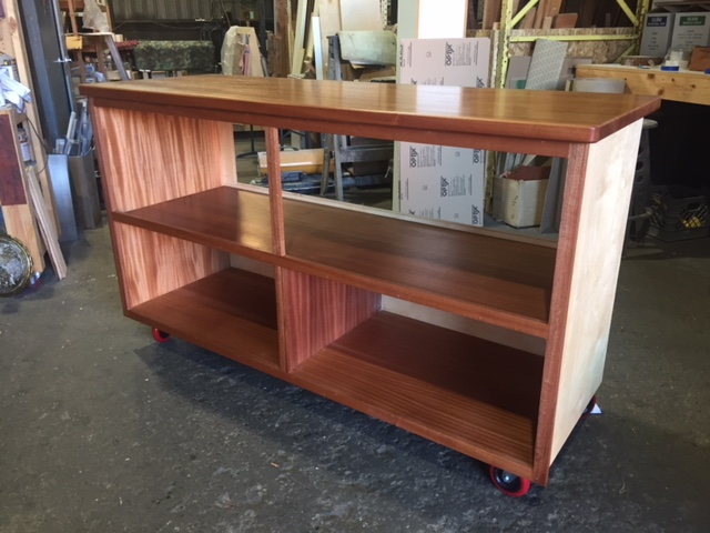 WoodLab Designs Humboldt Seed Organization Sapele custom trade show cabinet with locking caster wheels