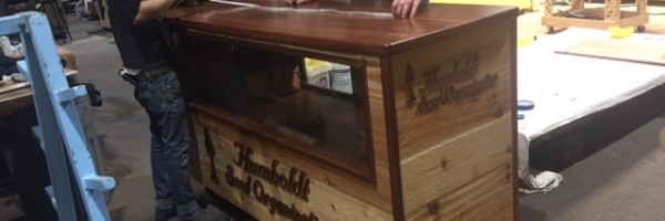 WoodLab Designs Cedar & Sapele Trade show cabinet for Humboldt Seed Organization light strip installation