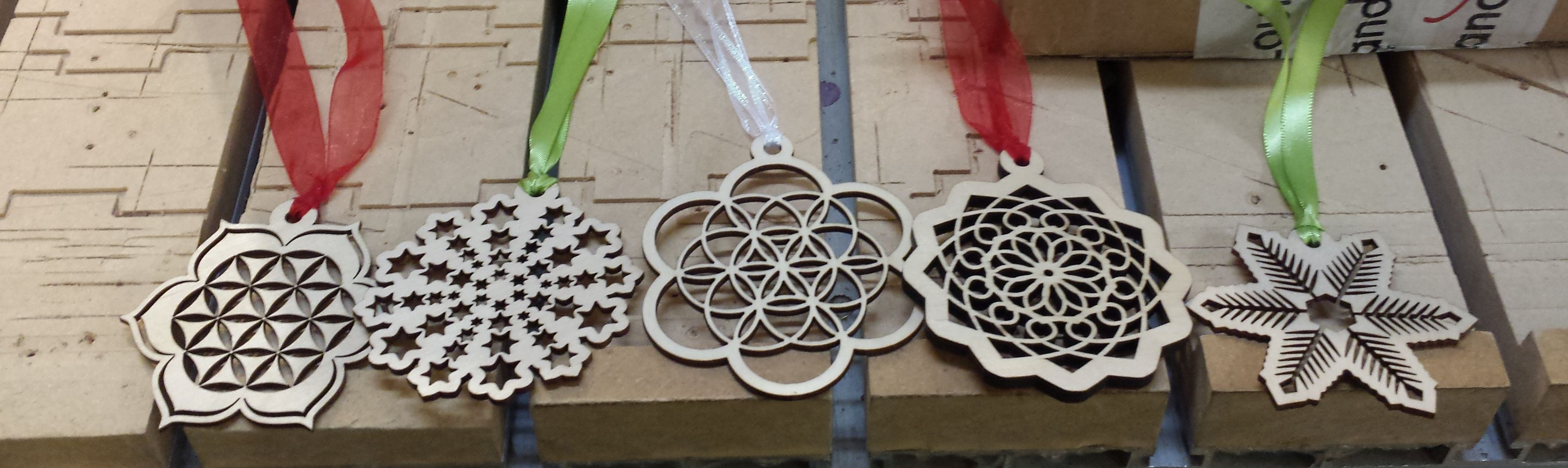 WoodLab Designs Geometric wooden ornaments with ribbon attachments