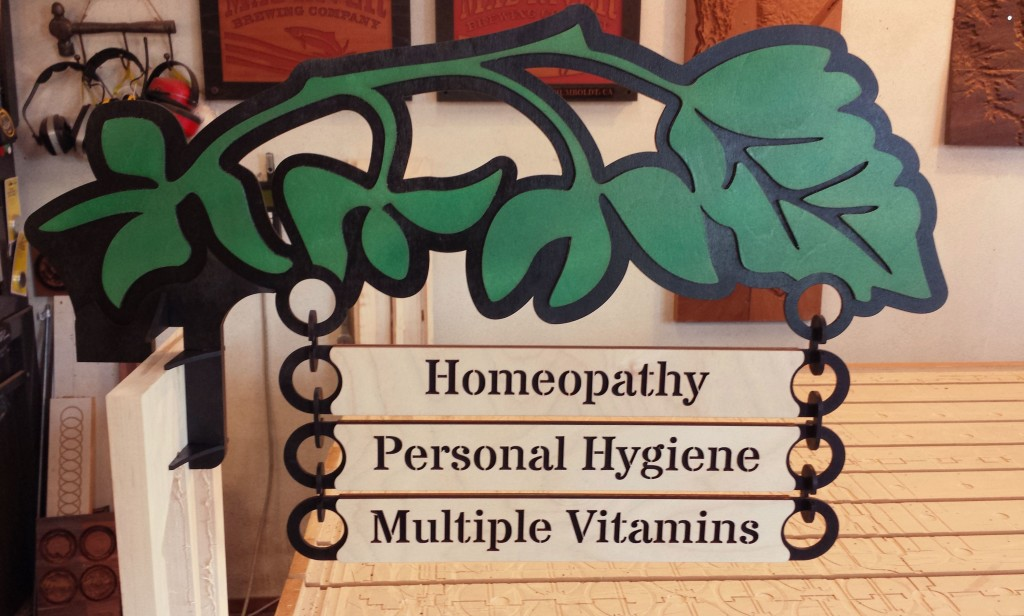 WoodLab Designs Wildberries Market Homeopathy Department signage