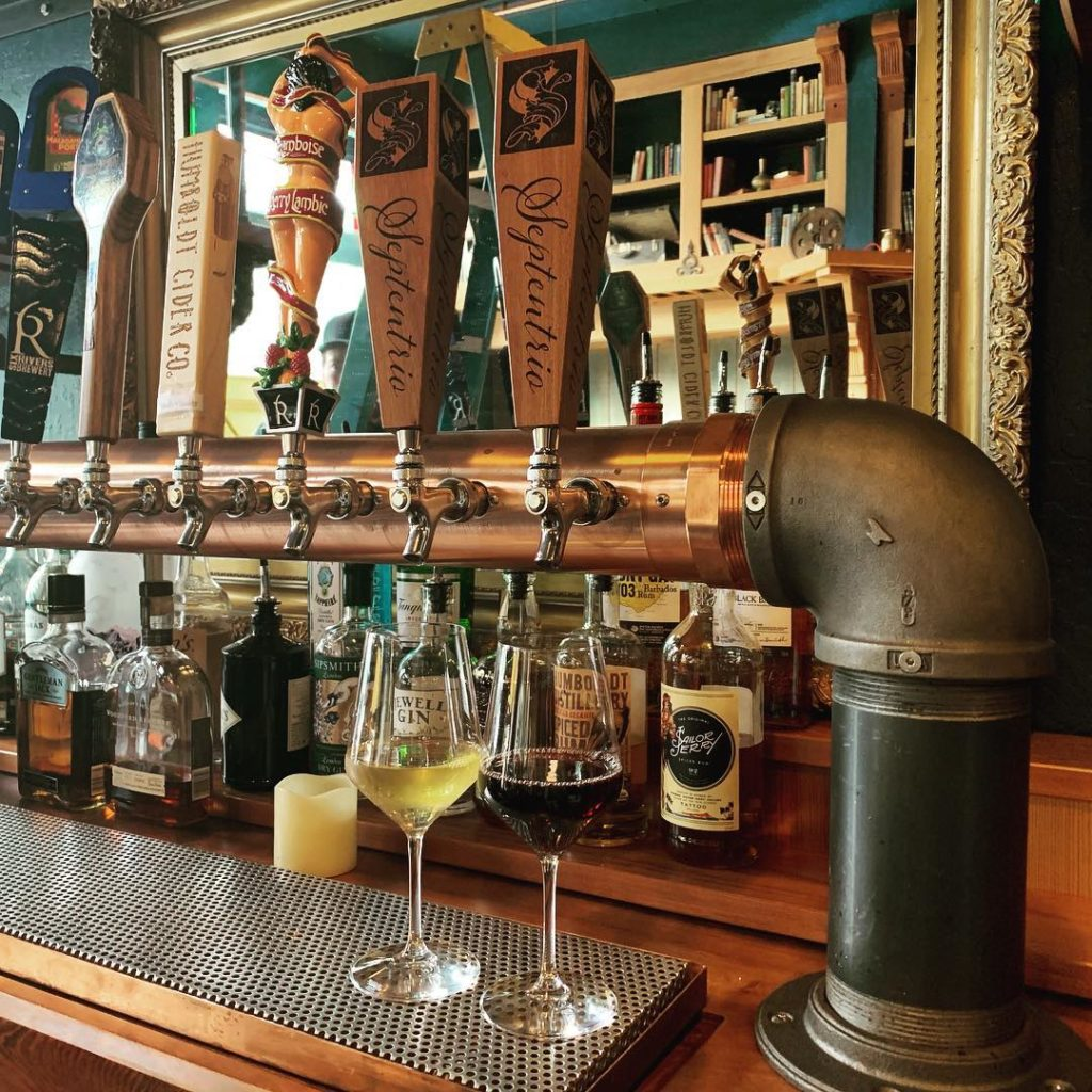 WoodLab Designs Custom Bar Shelving Unit, recycled Redwood countertops, and custom beer and wine tap handles