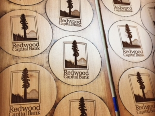 WoodLab Designs Redwood Capital Bank redwood coasters for custom promotional merchandise