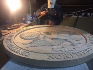 WoodLab Designs Northern District CNC Carved Courthouse Emblem getting a hand chiseled background