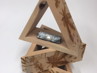 WoodLab Designs Triangular Dispensary Shelves made from Cedar wood with laser etched side panels for Above Cannabis